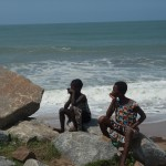 Two young Ghanaian girls sitting along the beach at Cape Coast just outside of the Elmina Castle.