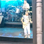 Adam Clayton groovin' to the beat, as Larry Mullen Jr. keeps the band in good time. <i>Photo by Ania Owczarczyk</i>.