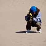 Great Sand Dunes National Park: Despite it being April, the blasting cold winds made it uncomfortable to hike without protection. Michigan gloves = GO BLUE! <i>Photo by Beata Owczarczyk</i>.