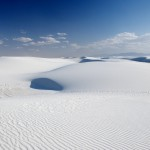 White Sands National Monument: No matter the temperature, this gypsum sand is never too hot. The water table is located a mere 3 feet below. Likewise, the white reflects most of the sun! <i>Photo by Ania Owczarczyk</i>.